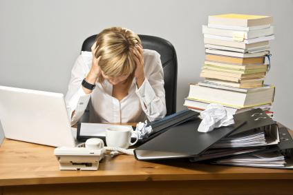disorganized woman at desk
