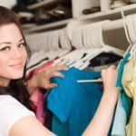 organizing clothes in a closet